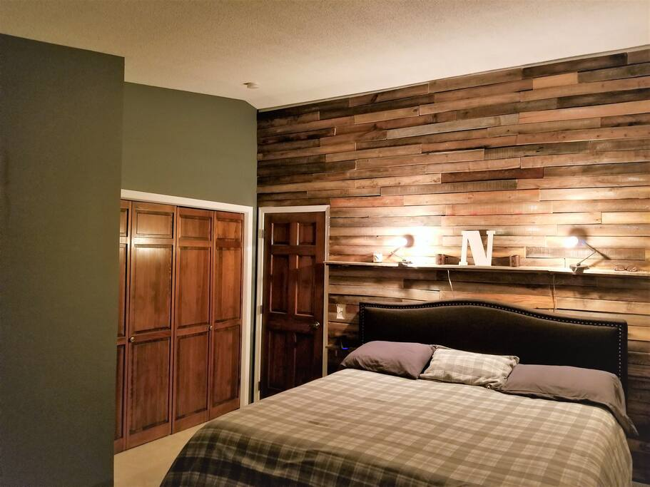 Newly remodeled Master Suite with blackout curtains, King Tempurpedic, and a rustic feel for added comfort.