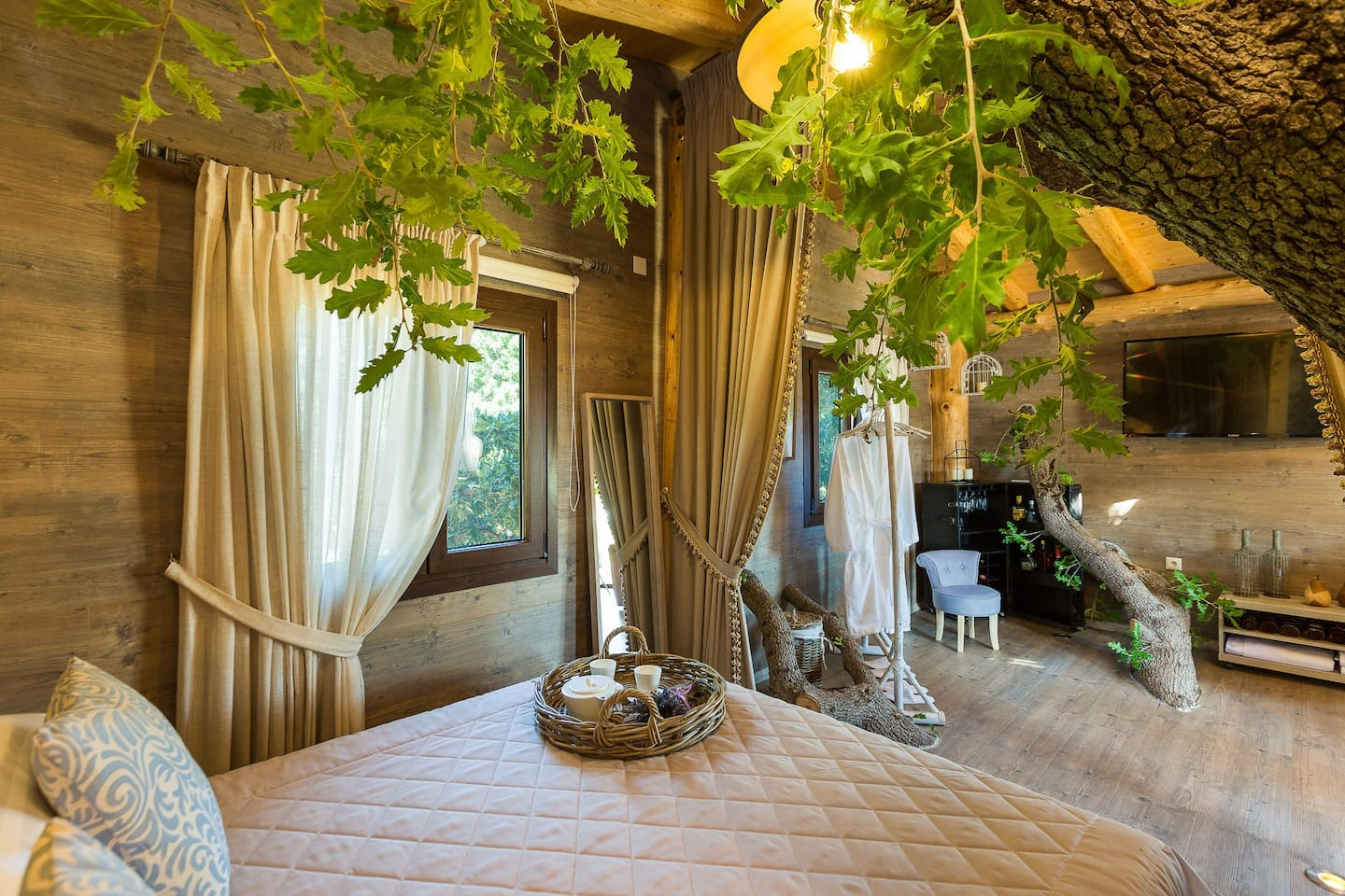 The wooden floors and ceilings and soft brown and grey tones of the fabrics and furniture, also add to the natural sensation of the rooms.