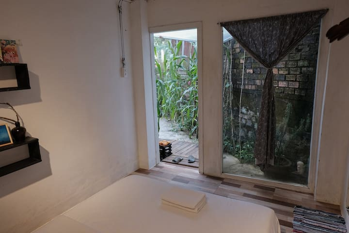Room G1: double room for 2 pax, with privated inside bathroom, main door & full glass window to front-yard