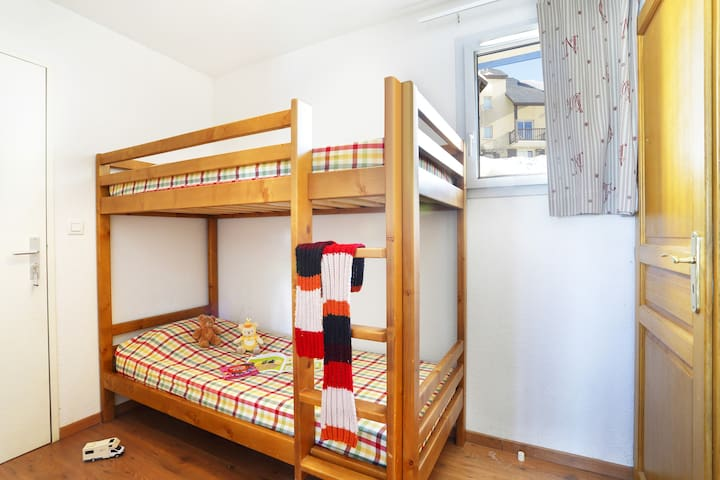 The sleeping alcove features a cozy Bunk bed.