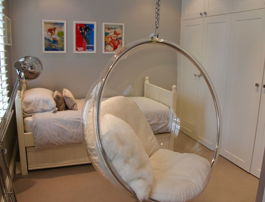 First floor bedroom with hanging chair