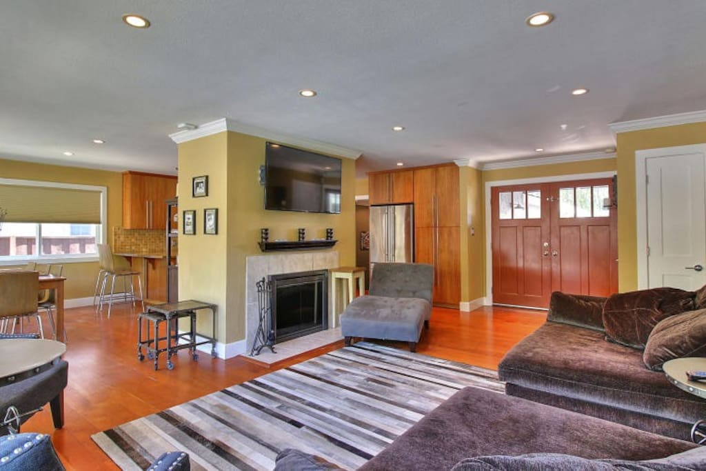 Open living room with wood fireplace