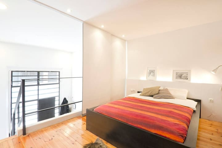 The third bedroom is accessed from a set of stairs that lead from the living space to a gallery