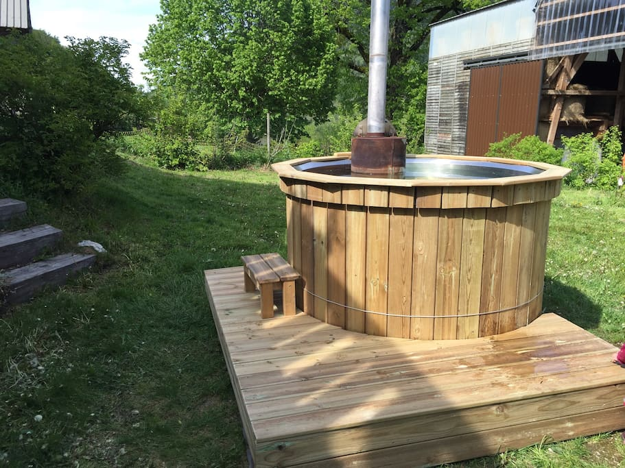The wood-fired hot tub in the backyard.