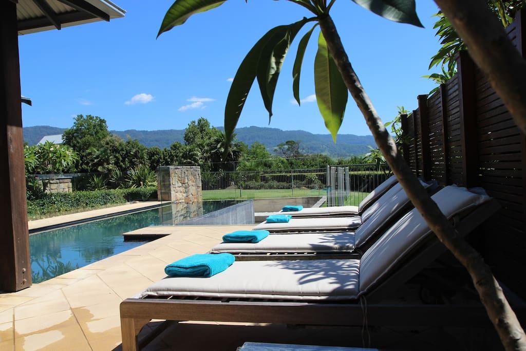 Pool gazebo and sun loungers