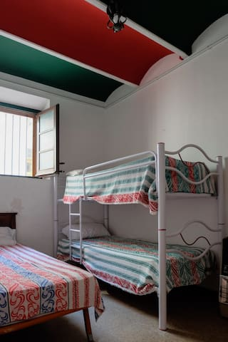 The sixth bedroom with triple beds. This room is located on the first floor.