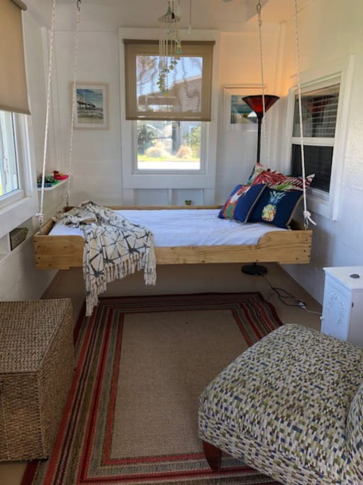 Front porch swinging bed