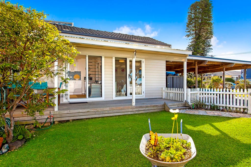 Fantastic well cared for lawns and gardens which are great for a BBQ with friends or to just sit and enjoy the sea breeze.