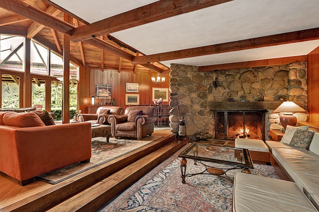 The Great Room features a sunken area with a river rock fireplace.