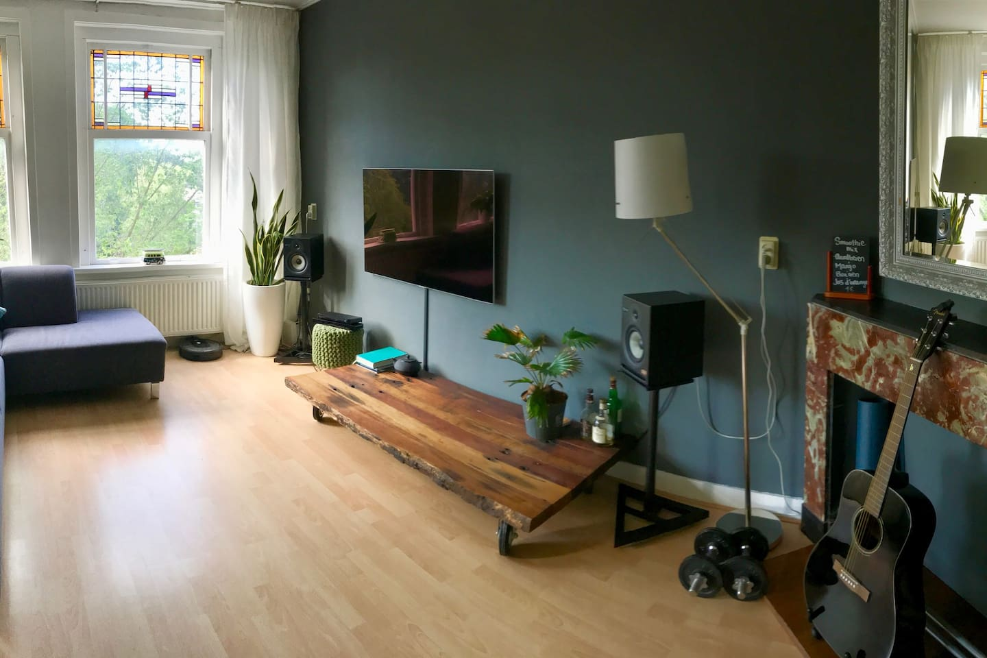A fish-eye overview of the living room with plenty of light.