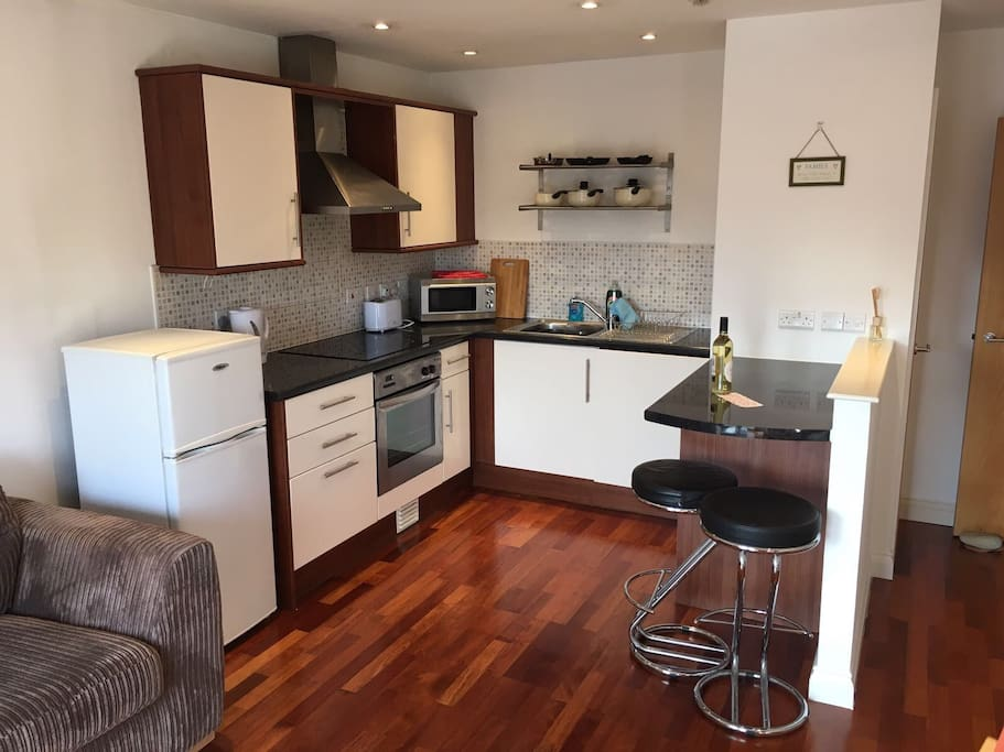Kitchen with fridge/freezer, cooker/hob and washing machine.