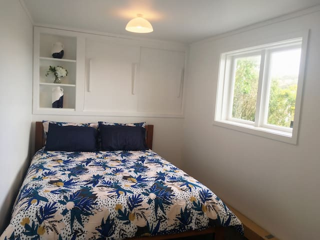 Queen size bed, comfy mattress, shelves and hanging rail for clothes so you can unpack for longer stays.
