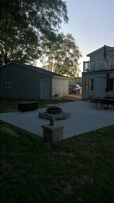 Back patio sits 8 with grill and beautiful fire pit