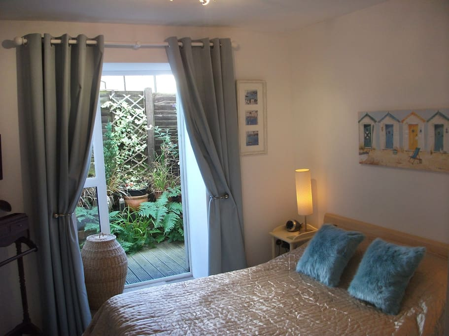 Main double bedroom and en suite with patio area.