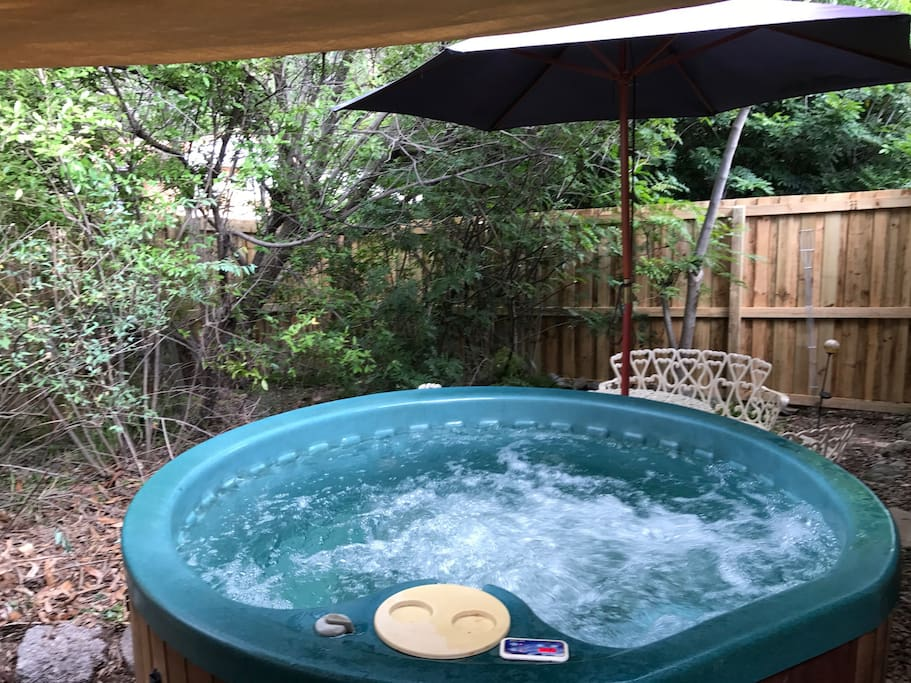 Private courtyard with spa off lockable main bedroom...kick back with a champagne or two!