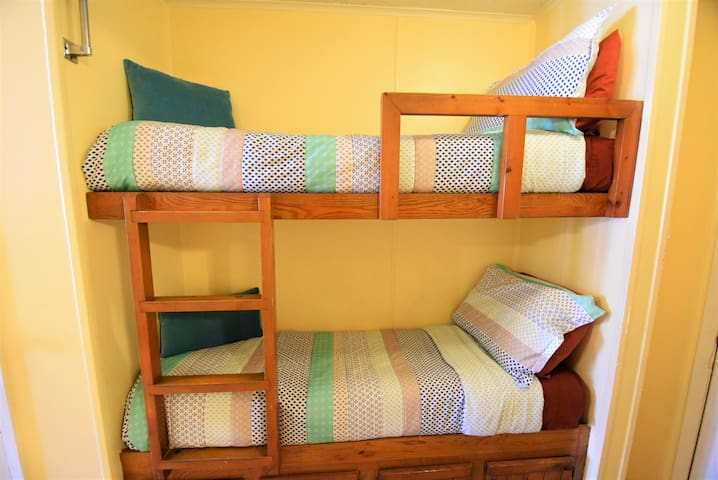 Children's bunks in the hallway, built into the wall