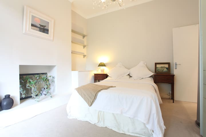 Comfortable double bed with lots of pillows, large wardrobe and night light