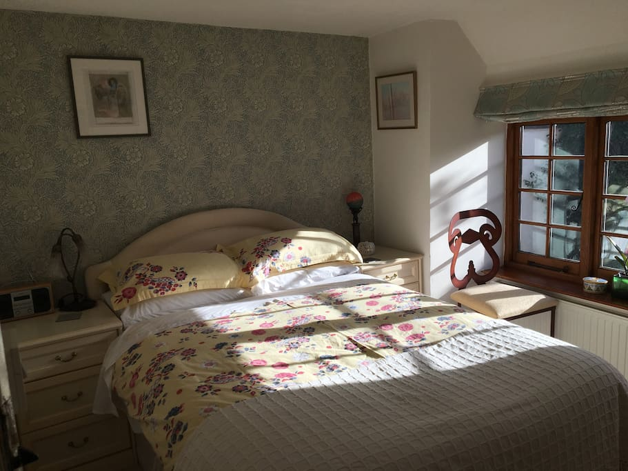 Large comfy bed with bedside table and lamp