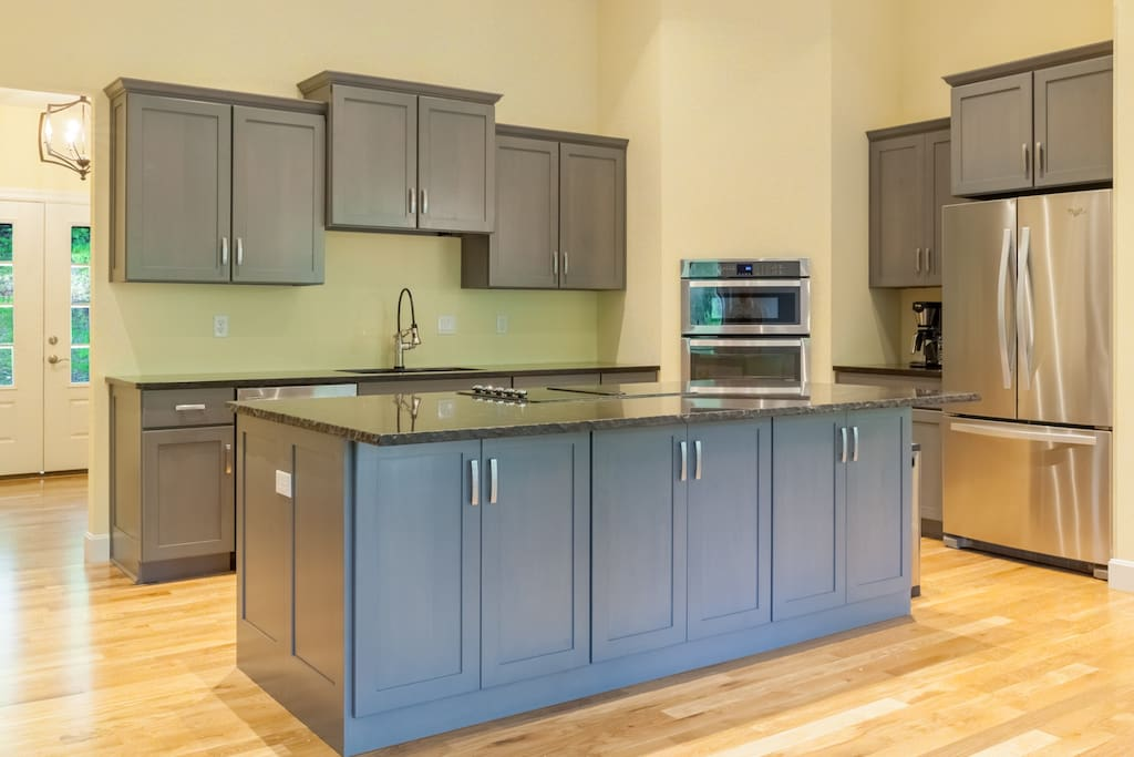 An open kitchen with brand new appliances and cookware