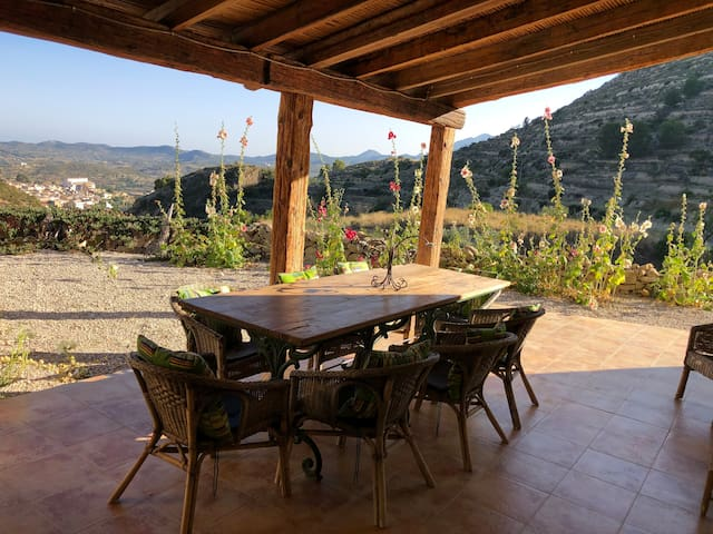 The covered terrace infront of the house is our favourite place to eat when it is hot. The view is down the valley our private valley onto Relleu town