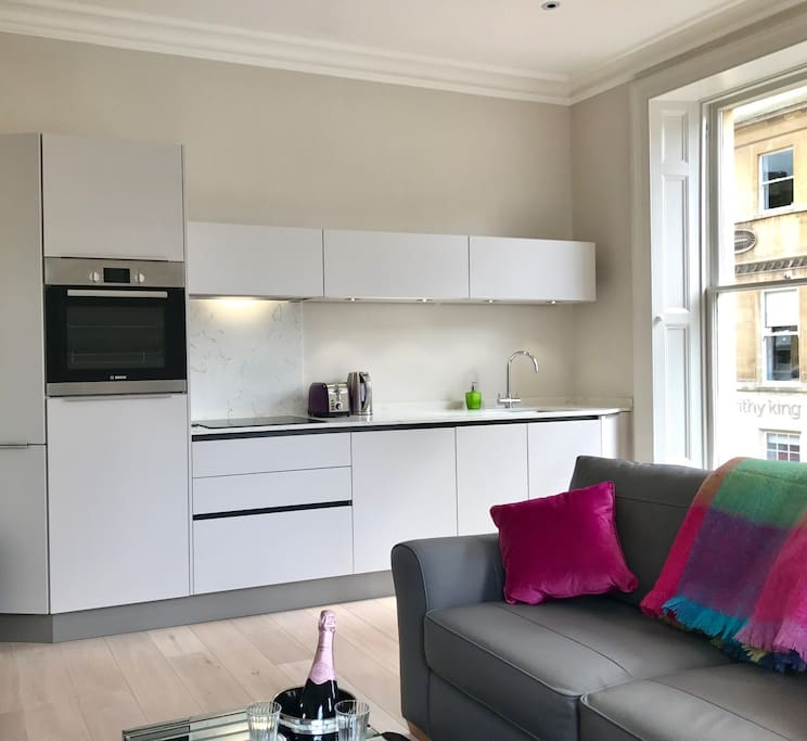 New flat with luxury appliances and leather sofa