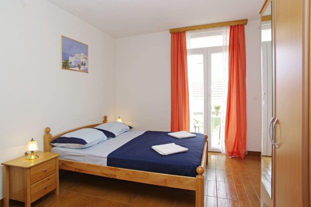 comfortable double bed & exit to the terrace