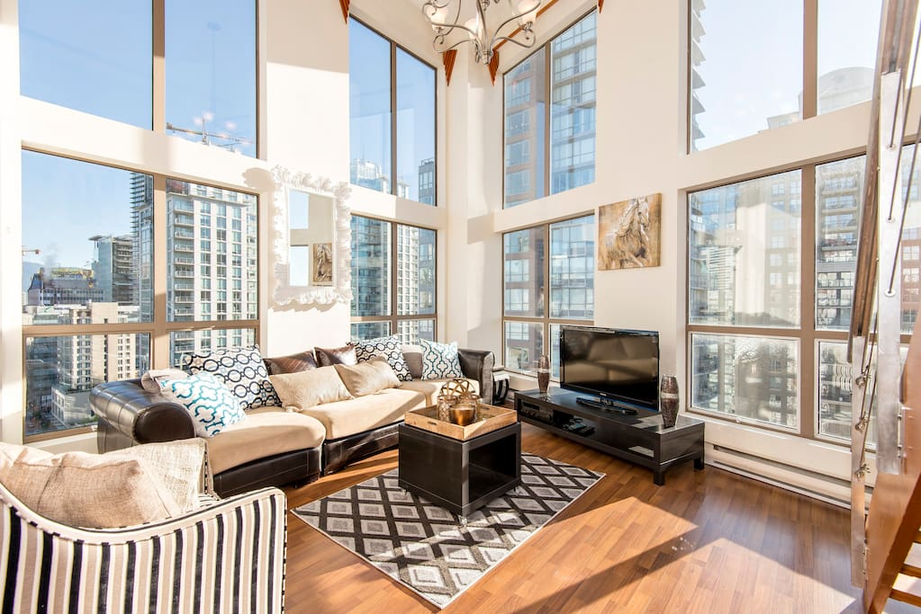 Open Floor Plan w/ HUGE 16 ft ceilings and large floor-to-ceiling windows - day shot