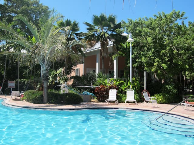 Coral Hammock features a beautiful pool and tiki hut.