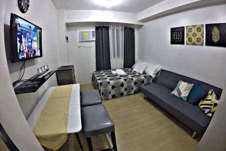 Comfy Vacation Home at Prime Location in QC - Кесон-Сити