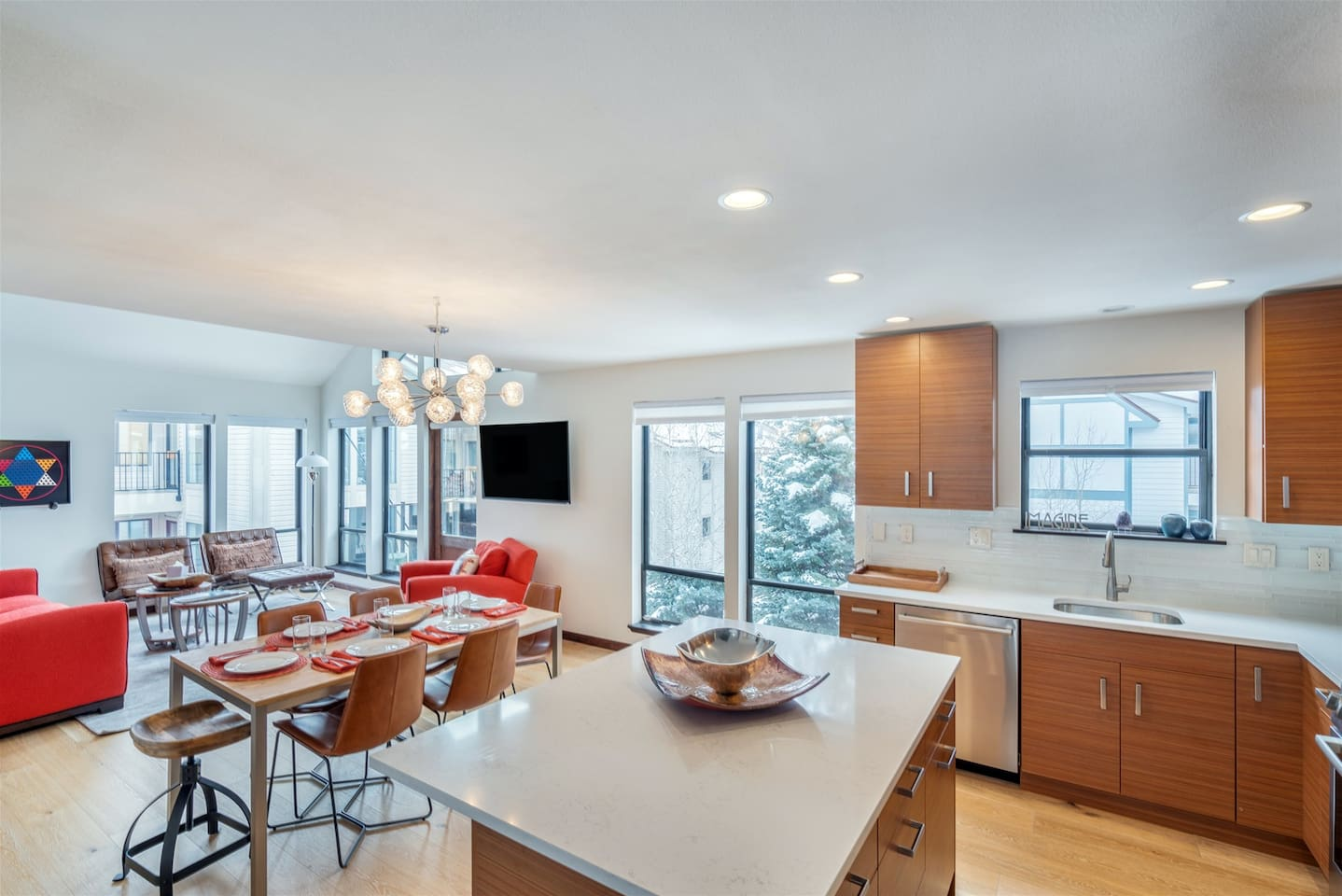 The open concept floor plan flows into the living room and pulls in the views outside