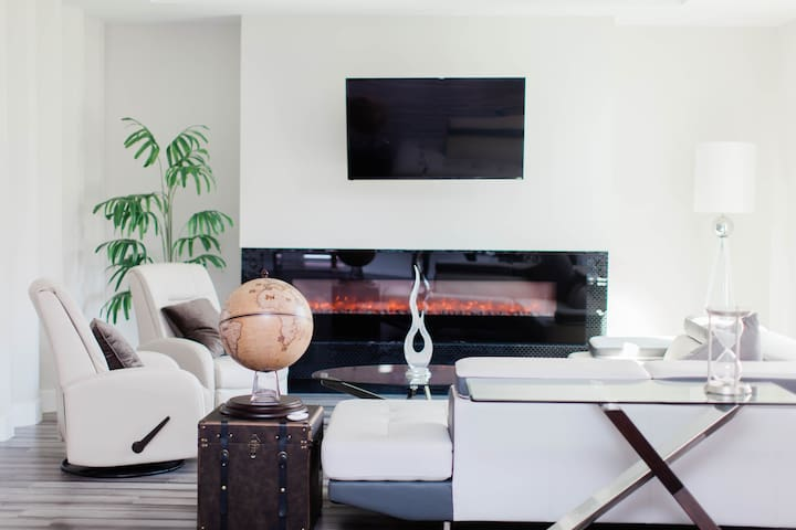 Living space with heated automatic fire place.