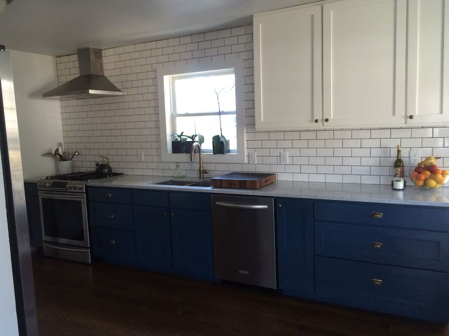 Kitchen with dishwasher, oven, stove, coffee maker