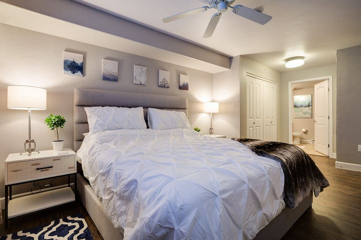 Master Bedroom with plush King size bed, flat screen tv connected to cable, and private bathroom.