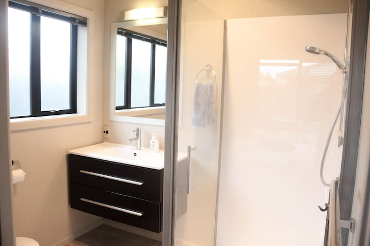 Your own shower with toilet and basin