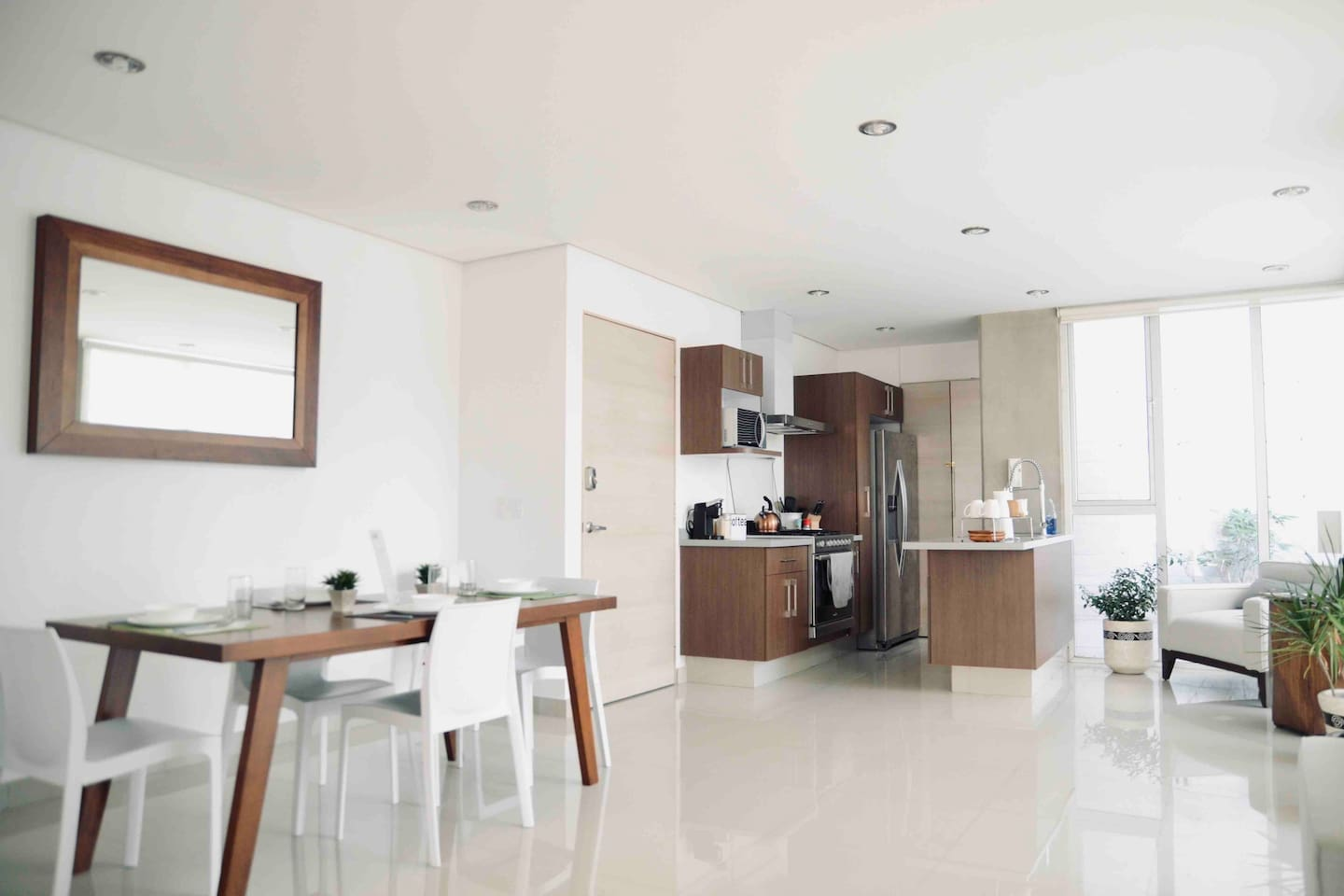 Spacious living and dining room with modern amenities. Plenty of natural sunlight when you want it.