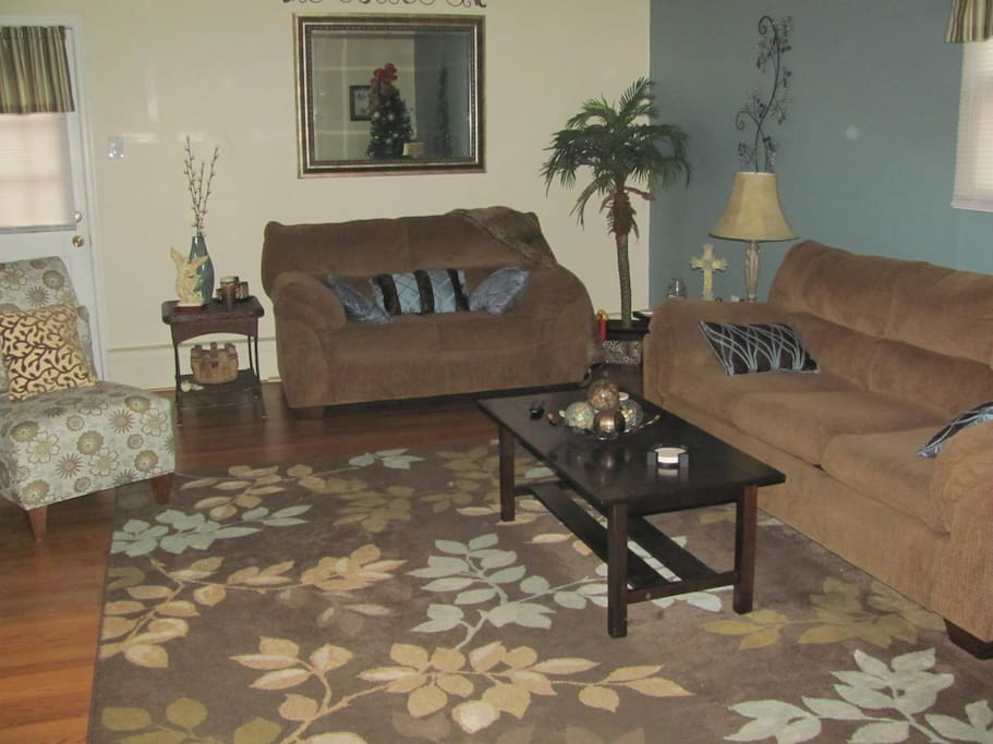 Common area with 55 Inch flat screen TV, mini fridge, pub table with two chairs.  22x15