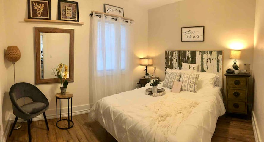 Queen bedroom. Equipped with a small Smart TV and has a large walk-in closet.