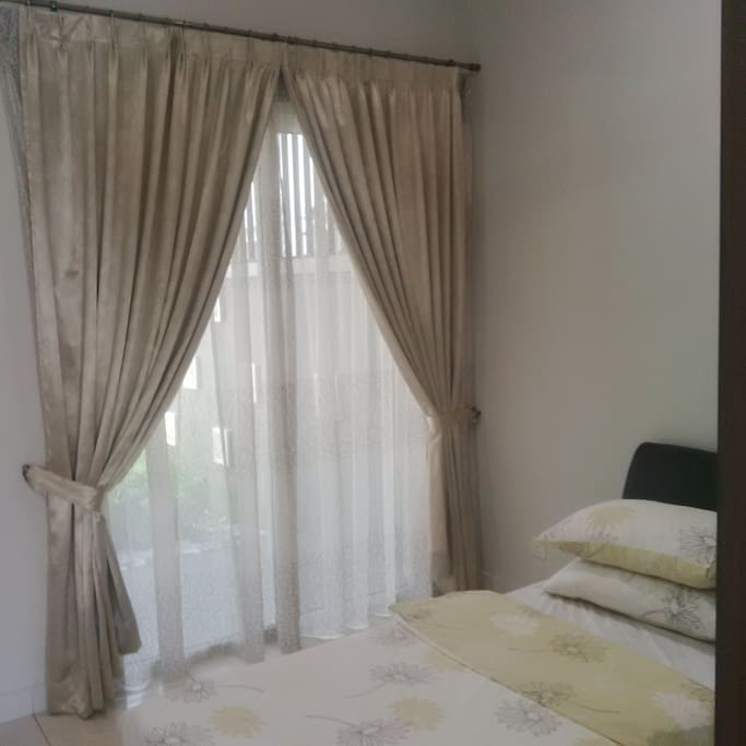 Tastefully decorated with day and night curtains, garden view. The room is shielded from the sun and always cool. The room is kept as a guest room only, and is hardly used. Furniture are still like new.