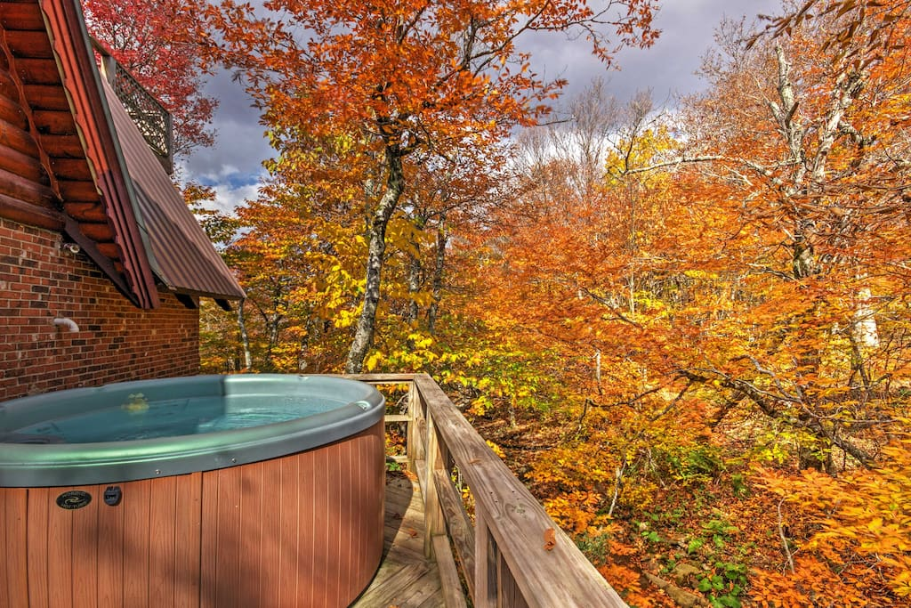 Enjoy spectacular views while unwinding in the soothing waters of the 5-person hot tub!