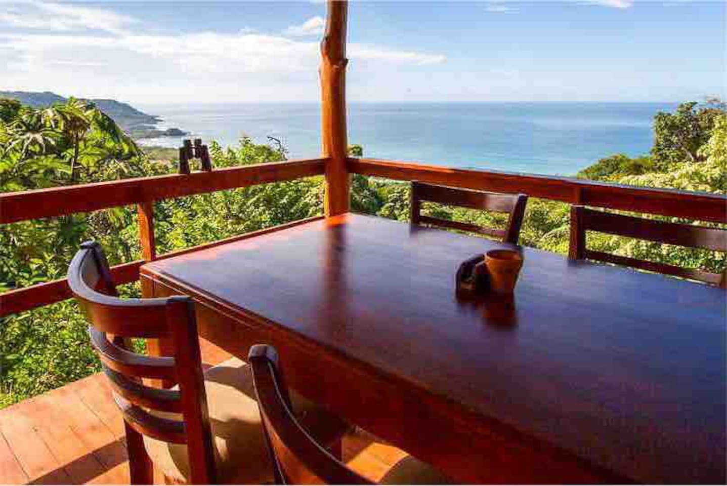 Enjoy your meals here on this custom teak dining table on your private deck!