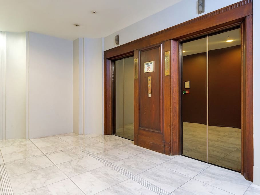 The elevator and marble flooring