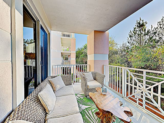 Enjoy the scenery and natural beauty from this spacious balcony with ample seating.