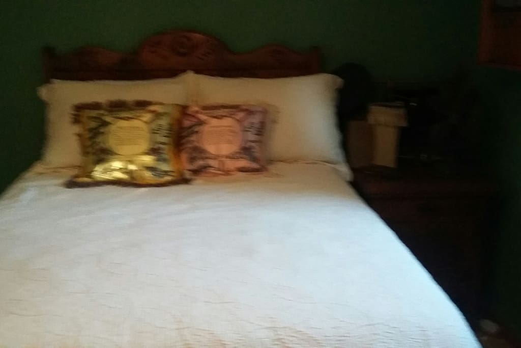 WWII Cabin antique bed with sweet heart pillows
