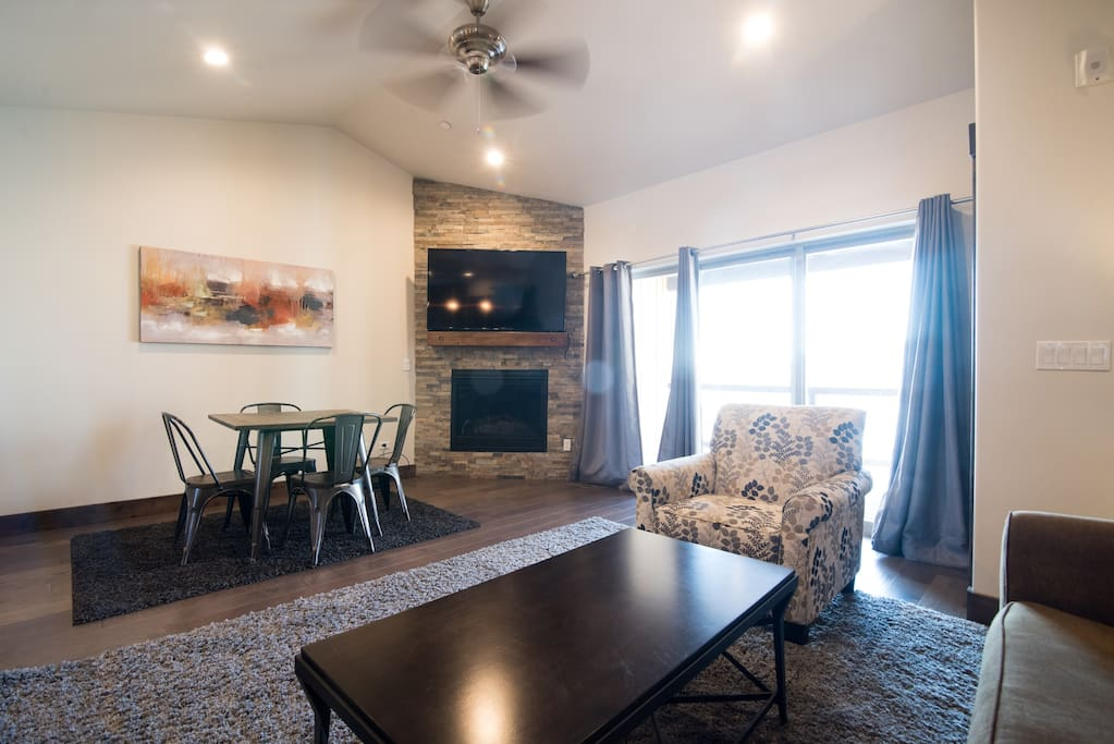 Family room with view of TV and access to balcony that views of Deer  Valley Ski Resort