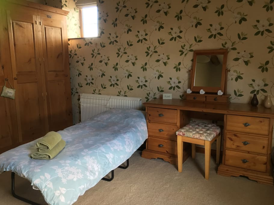 Example of main bedroom with additional put up bed in it