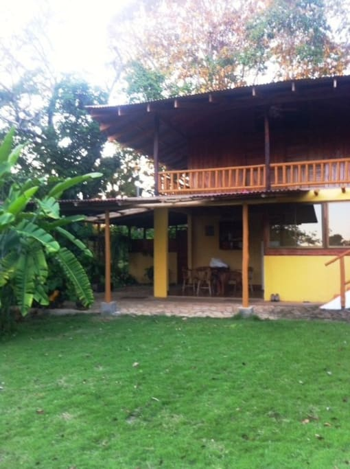 Out door open Kitchen below. Balcony with hammocks above .