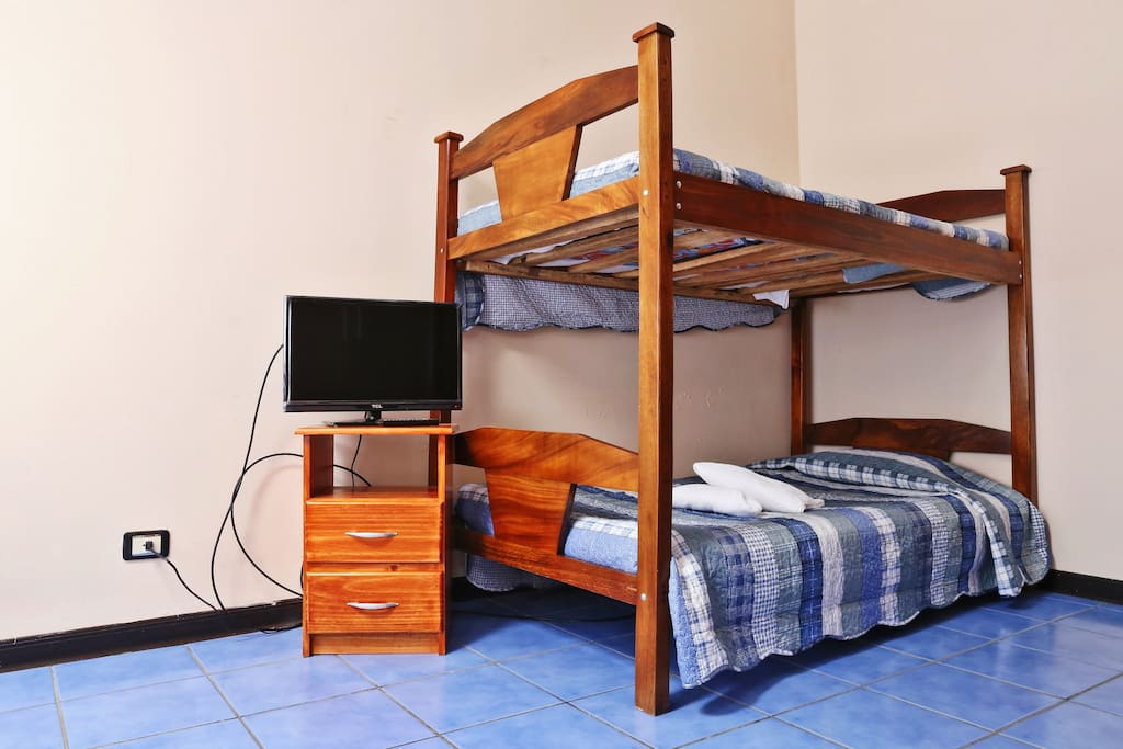 Note: We do not have bunk beds n this room, we now have a queen size bed and a double bed.