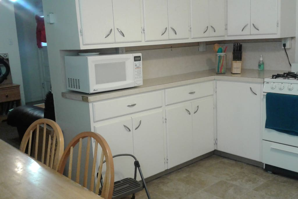 Shared kitchen area with available appliances and utensils.
