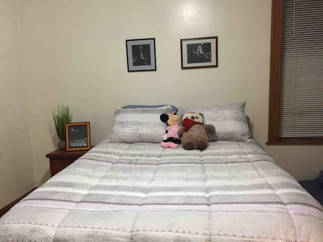 Large & airy with the most comfortable queen bed ever. This room is large enough for a twin bed and a pack and play if you need them.