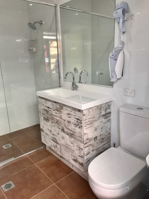 Shared Guest Bathroom complete with shower, toilet, basin and hairdryer. Towels included :-)